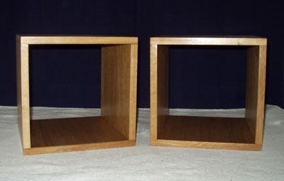 Front view of a pair of bedside tables in the form of a cube with open back and front