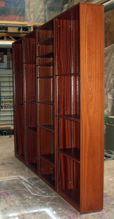Side view of a set of tall free-standing bookshelves