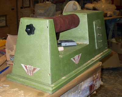 Three-quarter view of an old fashioned free-standing sanding machine