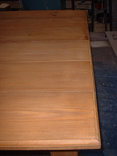Close up of the corner large pine table