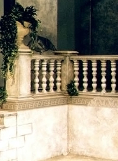 view of stage set - close up detail of a stone urn and balustrade