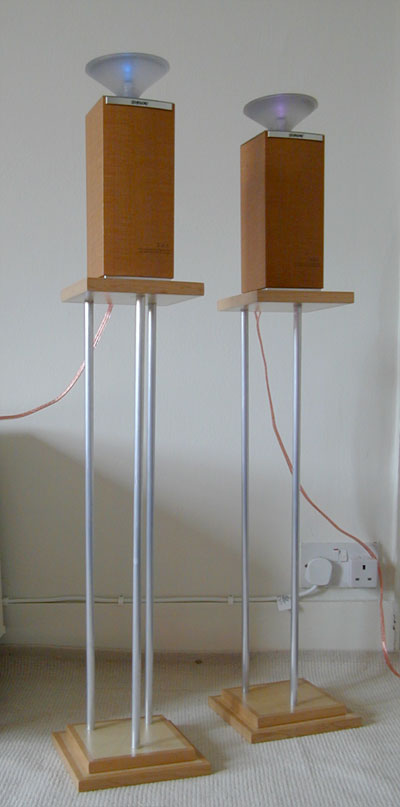 A matching pair of tall speaker stands with three aluminium supports