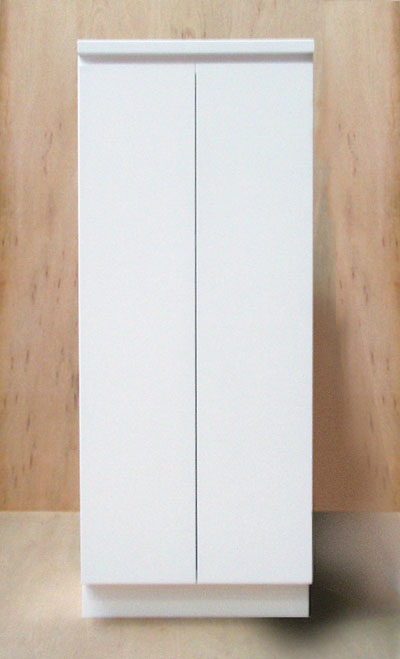 Front view of a white cabinet with the doors closed