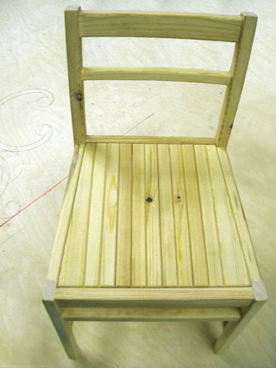Close view of the seat of a wooden chair